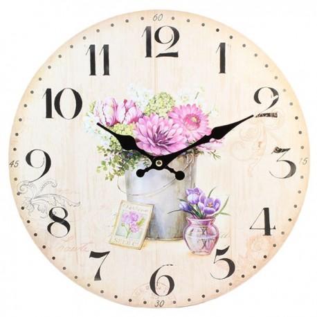 Okrągły zegar ścienny z jasną tarczą i kwiatowym motywem.