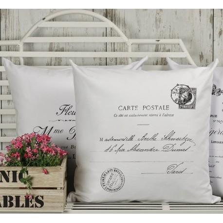 Biała poduszka z różnymi czarnymi francuskimi napisami