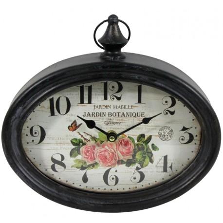 owalny zegar w czarnej metalowej ramie i białą tarczą z motywem róż
