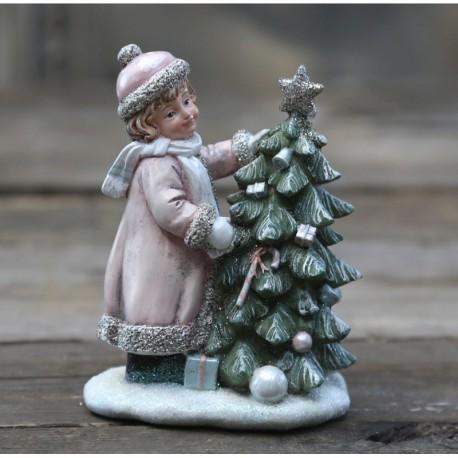 figurka dekoracyjna o kształcie dziewczynki z choinką