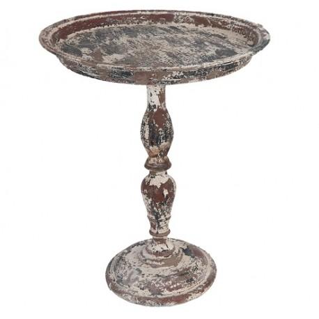 Ciemny metalowy stolik z okrągłym blatem i mocno przecieraną farba