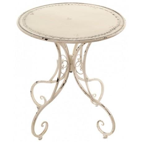 metalowy stół o jasnym kolorze z przetarciami posiadający okrągły blat i finezyjne nogi