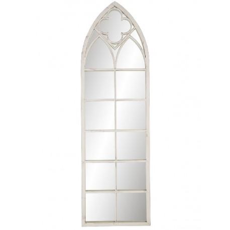 Wąskie lustro w białej ramie przypomina okno