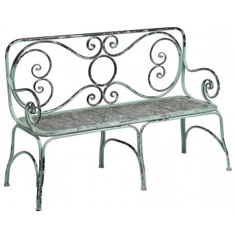 Zielona, postarzana ławka wykonana z metalu o ozdobnym kształcie