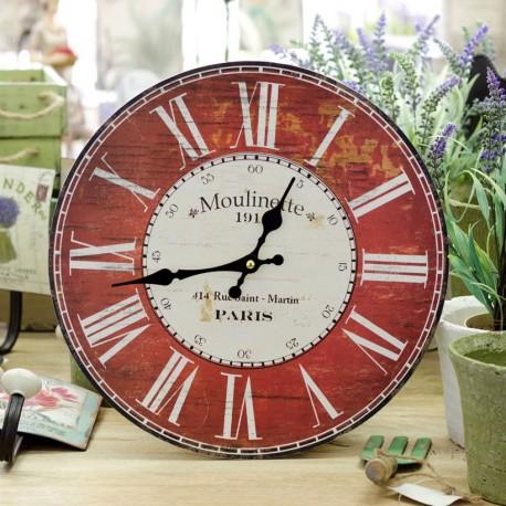 Piekny okragły zegar z czerwono białą tarczą