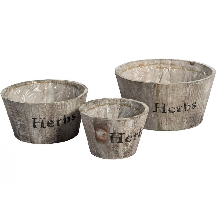 Okrągłe, drewniane osłonki na zioła firmy Belldeco. Wyłożone są folią od środka co zapobiegnie zawilgoceniu i zniszczeniu drewna.
