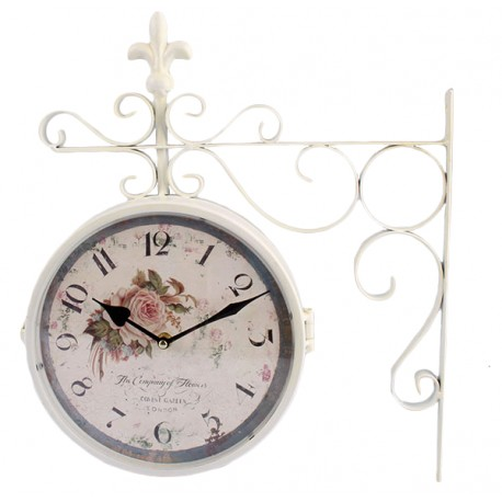 Piękny zegar dworcowy z motywem kwiatowym i białą ramą