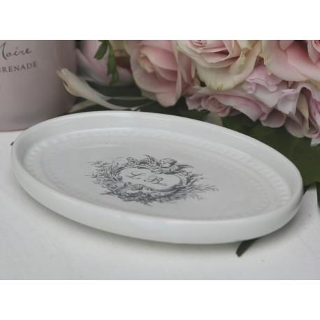 owalna biała mydelniczka z szarym napisem le bain