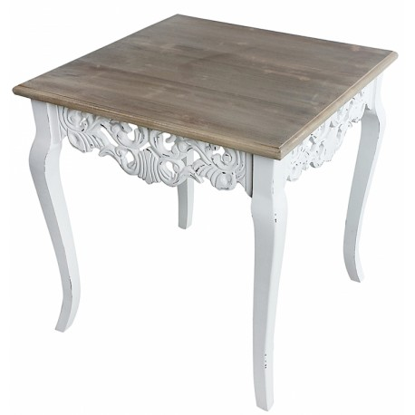 Niezwykle ozdobnie prezentujący się stolik kawowy z białą podstawą i brązowym blatem.