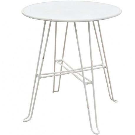 Okrągły stolik metalowy doskonale nadaje się do wykorzystania jako stolik kawowy w industrialnym salonie.