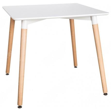 stół z białym kwadratowym blatem i drewnianymi nogami