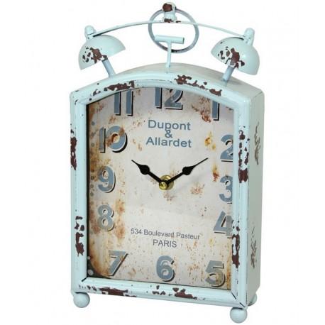 Zegarek stojący w styu Shabby Chic wykonany z metalu, pomalowany na jasny kolor niebieski z postarzoną tarczą.