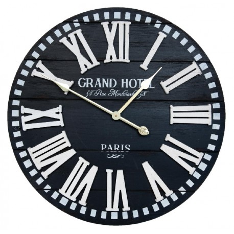 Czarny zegar okr ągły ozdobiony białymi cyframi oraz napisami