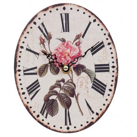 owalny jasny zegar z motywem róży posiadający postarzenia