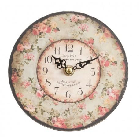 mały zegar z motywem kwiatowym