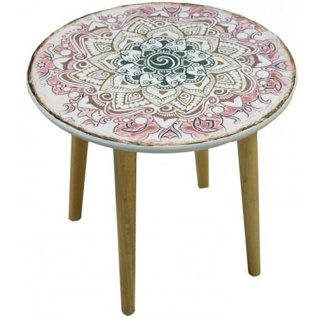 Piękny stół z okrągłym białym blatem umieszczonym na trzech nogach, ozdobiony został wzorem kwiatu