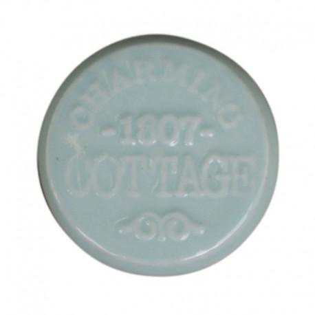 okrągła, ceramiczna gałka ozdobiona napisami