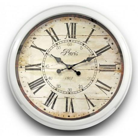 duży zegar z postarzaną tarczą i metalową ramą