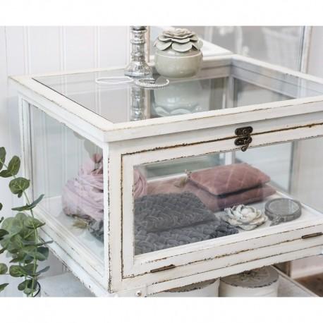 Biała szafka metalowa z przeszkloną szufladą to mebel typowo ekspozycyjny. Idealny do przechowywania najcenniejszych skarbów.
