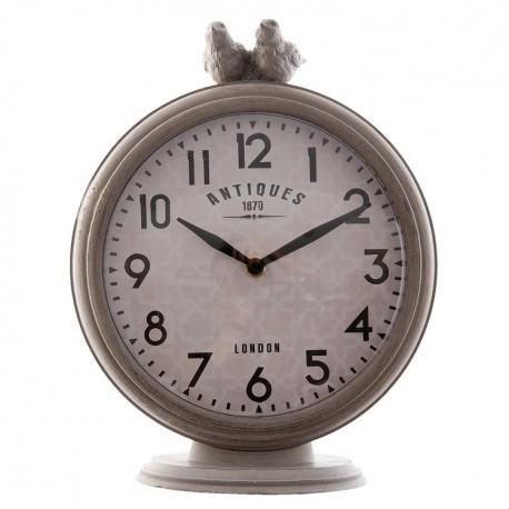 Stołowy zegar w jasno szarym kolorze z ozdobnymi ptaszkami