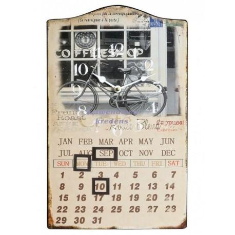 Metalowy obrazek na którym znajdziemy kalendarz oraz zegar