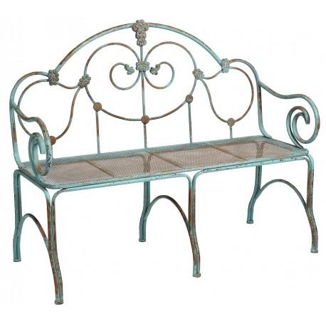 Zielonkawa ławka wykonana z metalu posiadająca ozdobne kształty