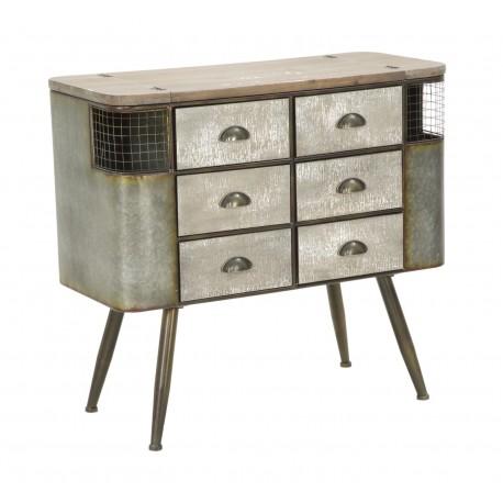 Metalowa komoda z szufladami ma owalny kształt i stoi na czterech prostych nogach metalowych.