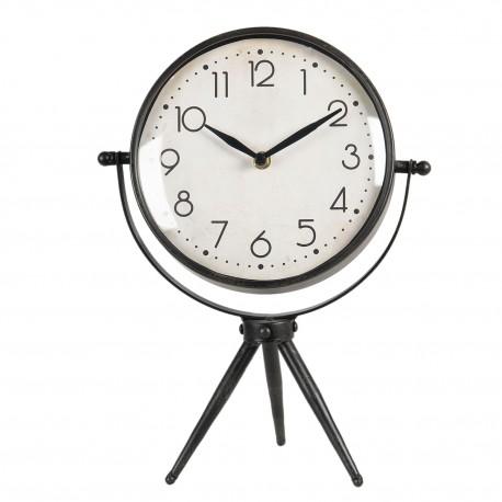Stojący zegar stołowy w stylu loft ma podstawę wykonaną z trzech prostych nóżek.