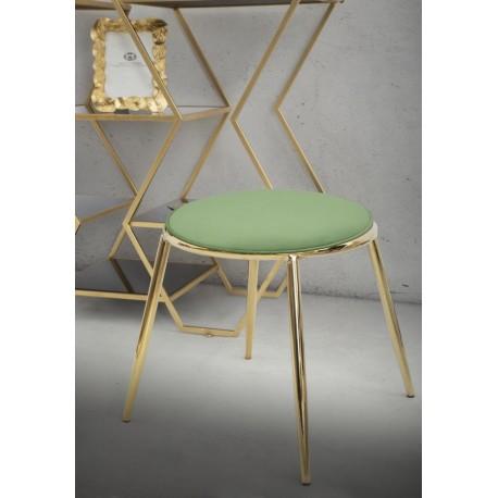 Złoty stolik z zielonym siedziskiem to mebel nie tylko atrakcyjny wizualnie ale również praktyczny i solidny.