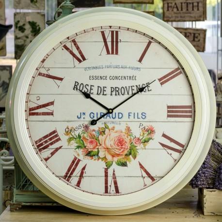 Duży zegar w metalowej ramie z motywem kwiatów