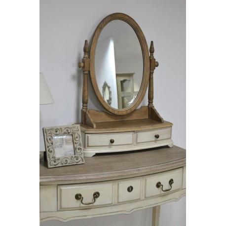 Owalne lustro z drewna z praktyczną podstawą, w której zawarte zostały dwie funkcjonalne szufladki.