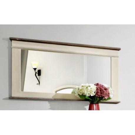 Prostokątne lustro w kremowej ramie pochodzi z kolekcji mebli Rimini, która wprowadzi do wnętrza odrobinę delikatności.